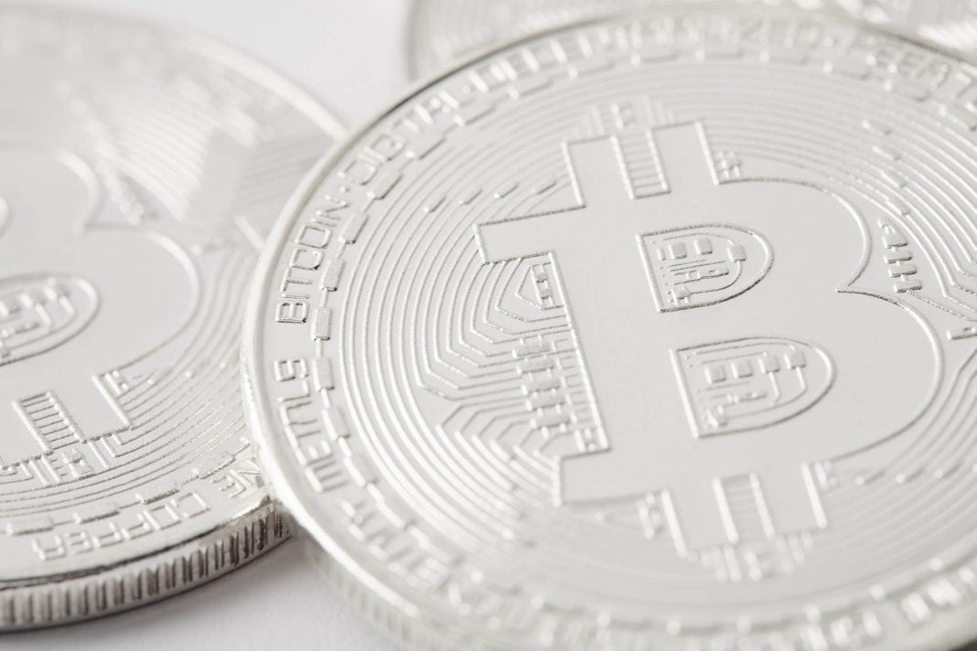 close-up shot of pile silver bitcoins