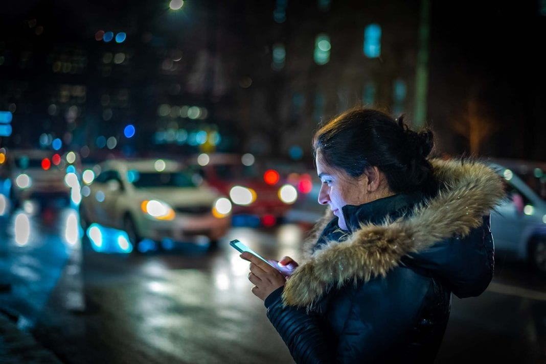 Girl Booking an online taxi